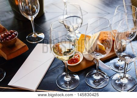 Wine and cheese tasting in South Africa estate in Western Cape wine-growing region poster
