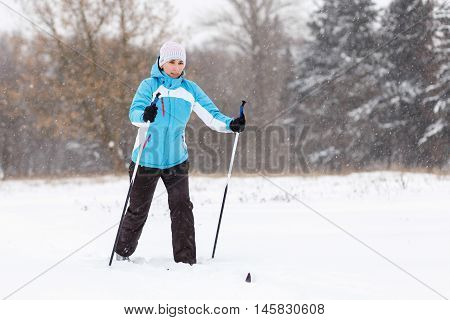 Young Woman Cross-country Skiing In Winter Park