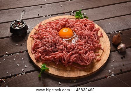 Minced Meat On A Wooden Desk