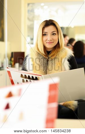 Beautiful Blonde Woman At Hairdresser Choosing New Proper Hairdo