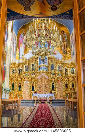 Zaporizhia/Ukraine- July 16, 2016: gorgeous interior of orthodox St. Nicholas Church with glass chandelier, icons  and paintings on dome. Church referred to Kiev Patriarchy. The building was completed in October, 2011.
