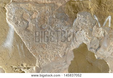 Old weathered crumbly plastered wall. Architectural details for texture or background.