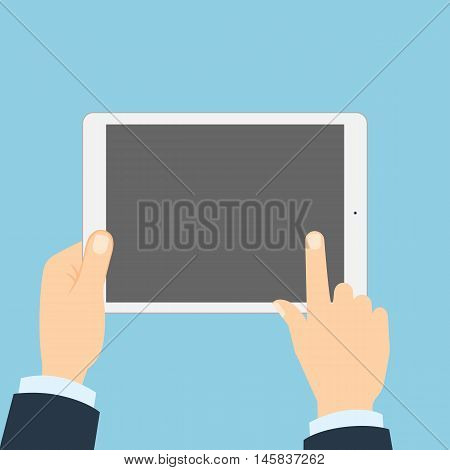 Hand touching tablet. White tablet with blank template screen. Finger touching screen.