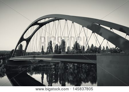 Modern bridge Frankfurt Osthafen toned image at dawn