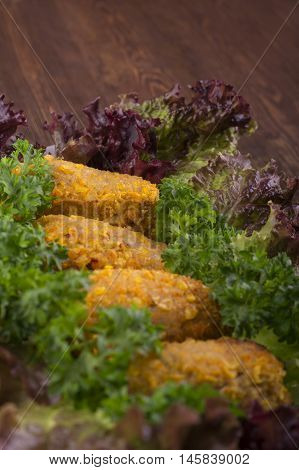 Rissole Meat Turkey On A Bed Of Fresh Lettuce And Parsley On A Wooden Background.