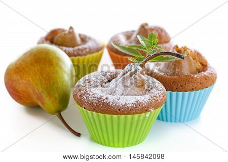 sweet muffins with pears on a white background