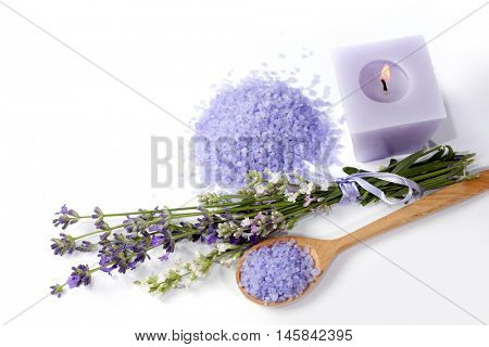 lavender, sea salt and candle for Spa and aromatherapy on a white background