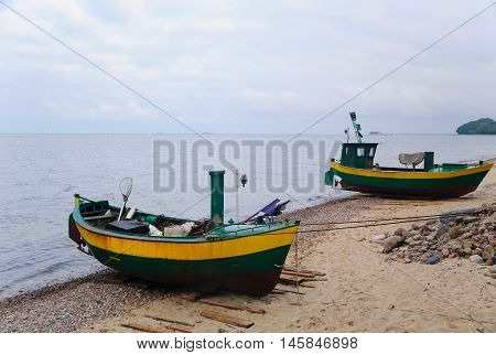 Old wooden fishing boats on the shore of Baltic sea