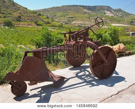 OMODOS, CYPRUS - SEPTEMBER 1, 2015: Winery Ktima Gerolemo Winery & Vineyards in the Troodos Mountains old subsoil plows