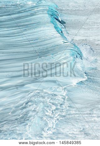 vertical Fresh Water Abstract showing movement in the form of a wave and clear blue refreshing colors shot out side on a summers day for a background banner copy space and events