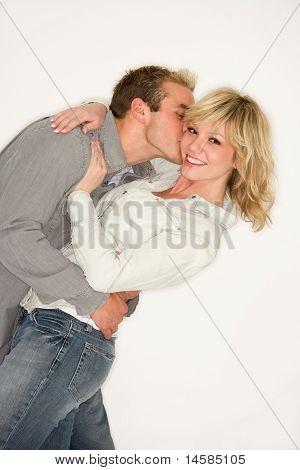 Young Couple Kiss