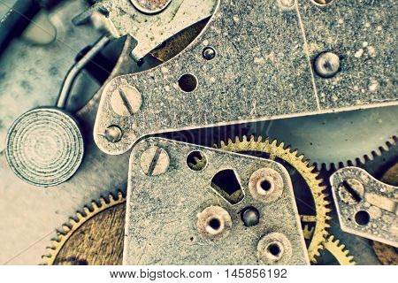 Inside of pocket watch.Clock Mechanism with Gears Macro Background.Toned image.