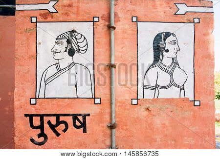 BIKANER, INDIA - MAR 4, 2015: Pictures indicate the location of toilets for men and women on March 4, 2015. Bikaner has population near 650000. It was founded by maharaja Rao Bika in 1486