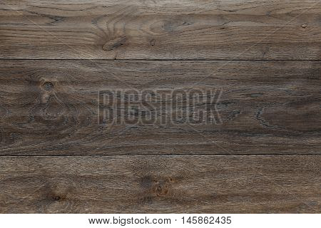 Texture dark brown parquet as abstract texture background, top view. Material wood, oak, maple