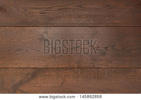 Texture dark parquet as abstract texture background, top view. Material wood, oak, maple