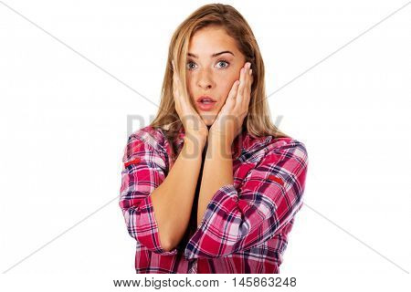 Portrait of surprised woman holding her head