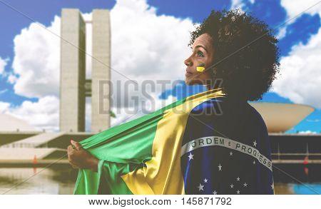 Woman holding the flag of Brazil in Brasilia