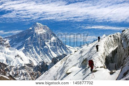 view of Everest and Lhotse from Gokyo valley with group of climbers on glacier way to Everest base camp Sagarmatha national park Khumbu valley Nepalese Himalayas