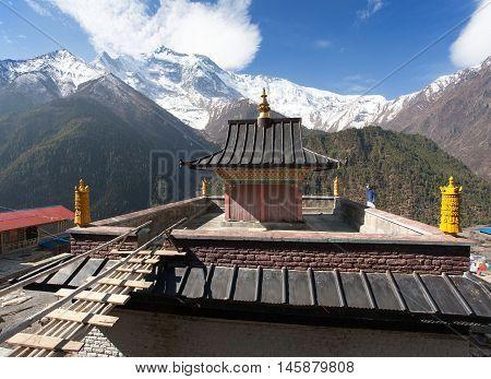 Upper Pisang view of gompa and Annapurna 2 II round Annapurna circuit trekking trail Nepal