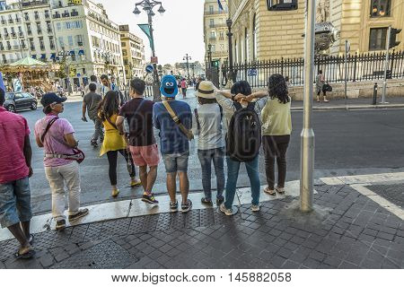 Tourists Visit The Town Of Marseilles