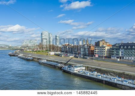 Cologne Skyline With Ships On Pier