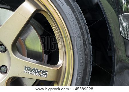 Bangkok, Thailand - September 4, 2016: A Mazda RX8 is wearing Volk Rays TE37 Golden 18 inches Rim.