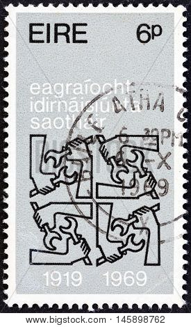 IRELAND - CIRCA 1969: A stamp printed in Ireland issued for the 50th anniversary of International Labor Organization shows Quadruple I.L.O. Emblems, circa 1969.