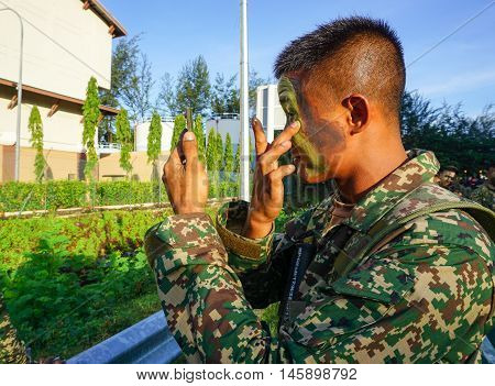 Kota Kinabalu,Sabah-Aug 31,2016:Military man in makeup to camouflage ready for marching on National day,celebrating the 59th anniversary of independence on 31st Aug 2016 at Kota Kinabalu,Sabah
