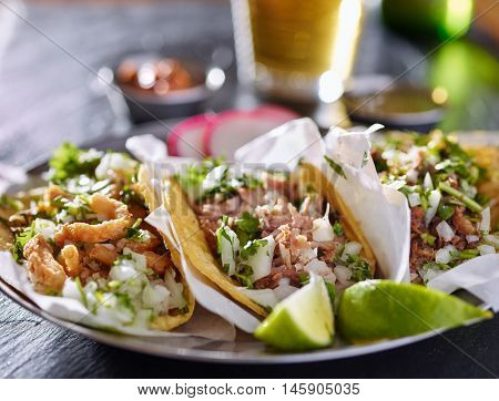 tasty plate with three authentic mexican tacos