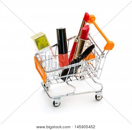 Makeup in pushcart isolated on white background.