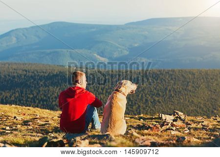 Man With Dog On The Trip In The Mountains