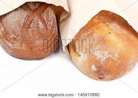 Bread in a paper bag isolated on white background.