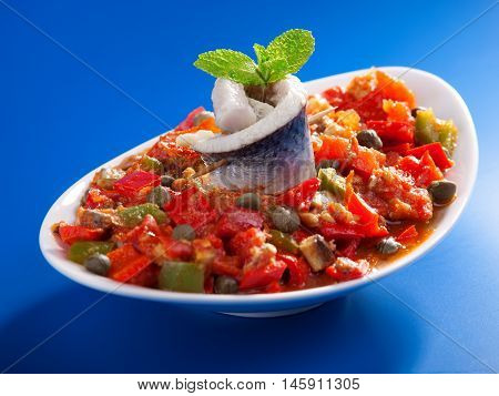 Tunisian salad with red peppers marinated fish and capers. Full length.