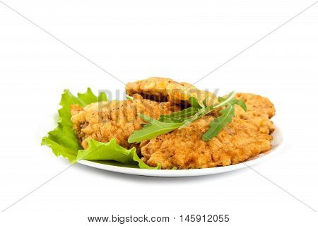 Steaks and lettuce isolated on a white background.