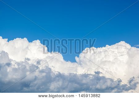 Blue sky with the a clouds closeup.