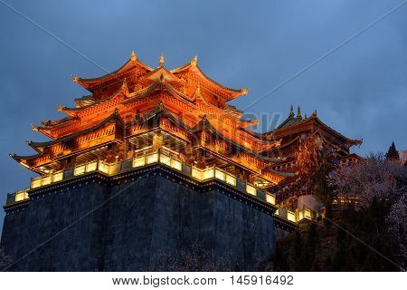 The light from the temple at night in Shangri-la, China.