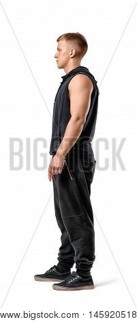 Side view of muscled young man standing, isolated on white background. Bodybuilding and self-improvement. Physical training. Beauty and strength.