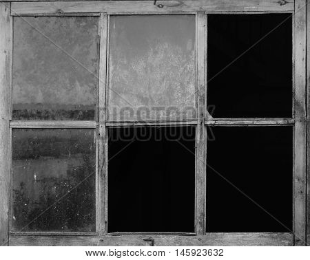 The old window in a building retro black white glass room darkness frame