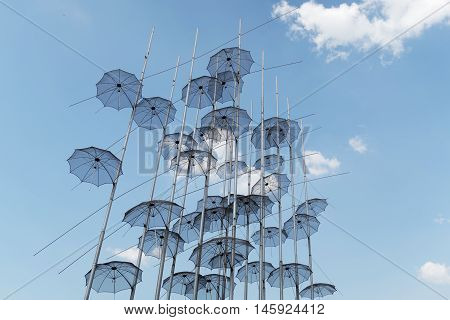 Thessaloniki, Greece - September 04 2016: Umbrellas art at Thessaloniki seafront. This work created by artist George Zongolopoulos was installed to be seen free at the waterfront of Thessaloniki in 1997.