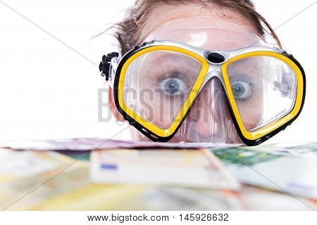 woman is diving or swimming in a lot of euros