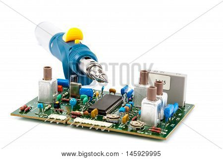 Gas Powered Soldering and electronic board isolated on a white background.