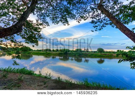 Beautiful view of the Magdalena River framed by trees in Mompox Colombia