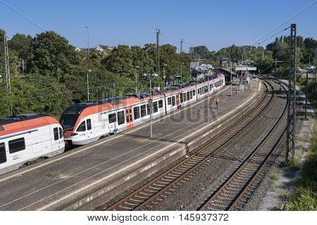 Mainz-Kastel, Germany - August 27, 2016: German regio train Rheingau line arrives at railway station Mainz-Kastel some passengers on the platform.