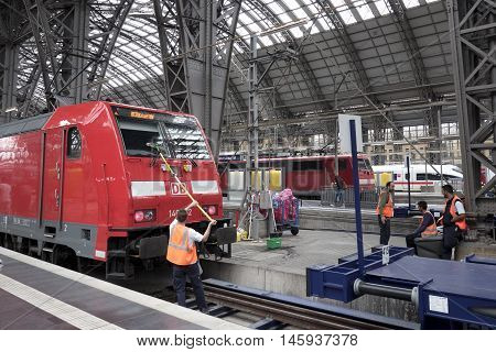 Frankfurt, Germany - August 25, 2016: Waiting trains and cleaning staff at railroad station platform Frankfurt. Hauptbahnhof Frankfurt is one of the largest train stations in Germany and a very important traffic hub in the Rhein-Main-area with both nation