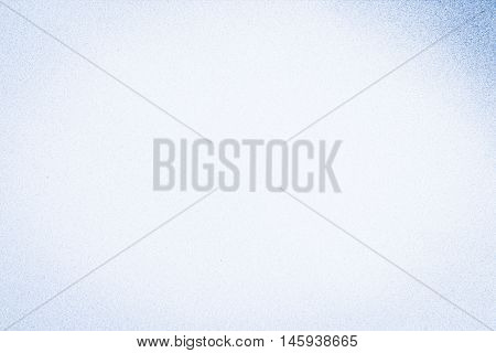 Full frame pale blue mottled background in horizontal 3:2 format.