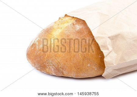 Loaf of bread in a eco-friendly paper bag isolated on white background.