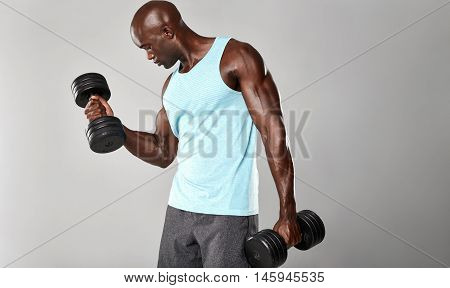African Fitness Model Working Out With Dumbbells