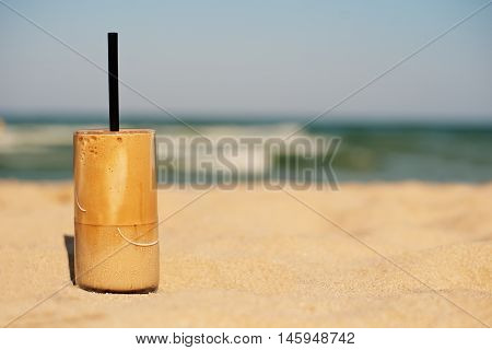 Frappe, Ice Coffee On The Beach. Summer Iced Coffee (frappuccino, Frappe Or Latte) In A Tall Glass O