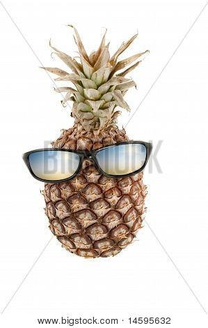 Pineapple as human head and sunglasses with color reflections