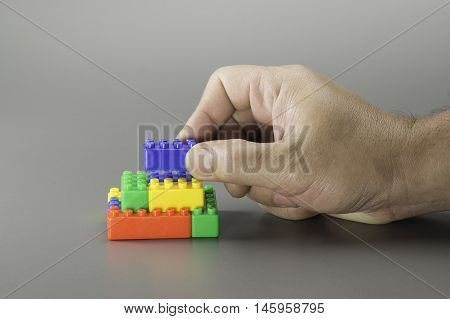 Brick Toy And Hand